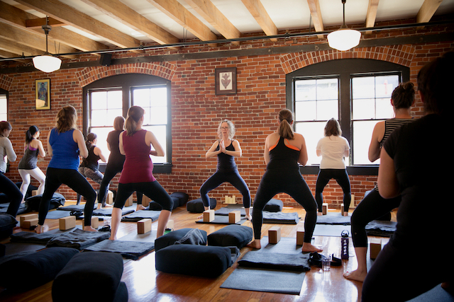 Carol Gray Leads Her Pregnant Students in Goddess Pose With Lion