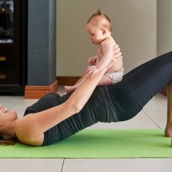 New Mother Practices Online Postpartum Yoga With Her Baby at MamaSpace Yoga