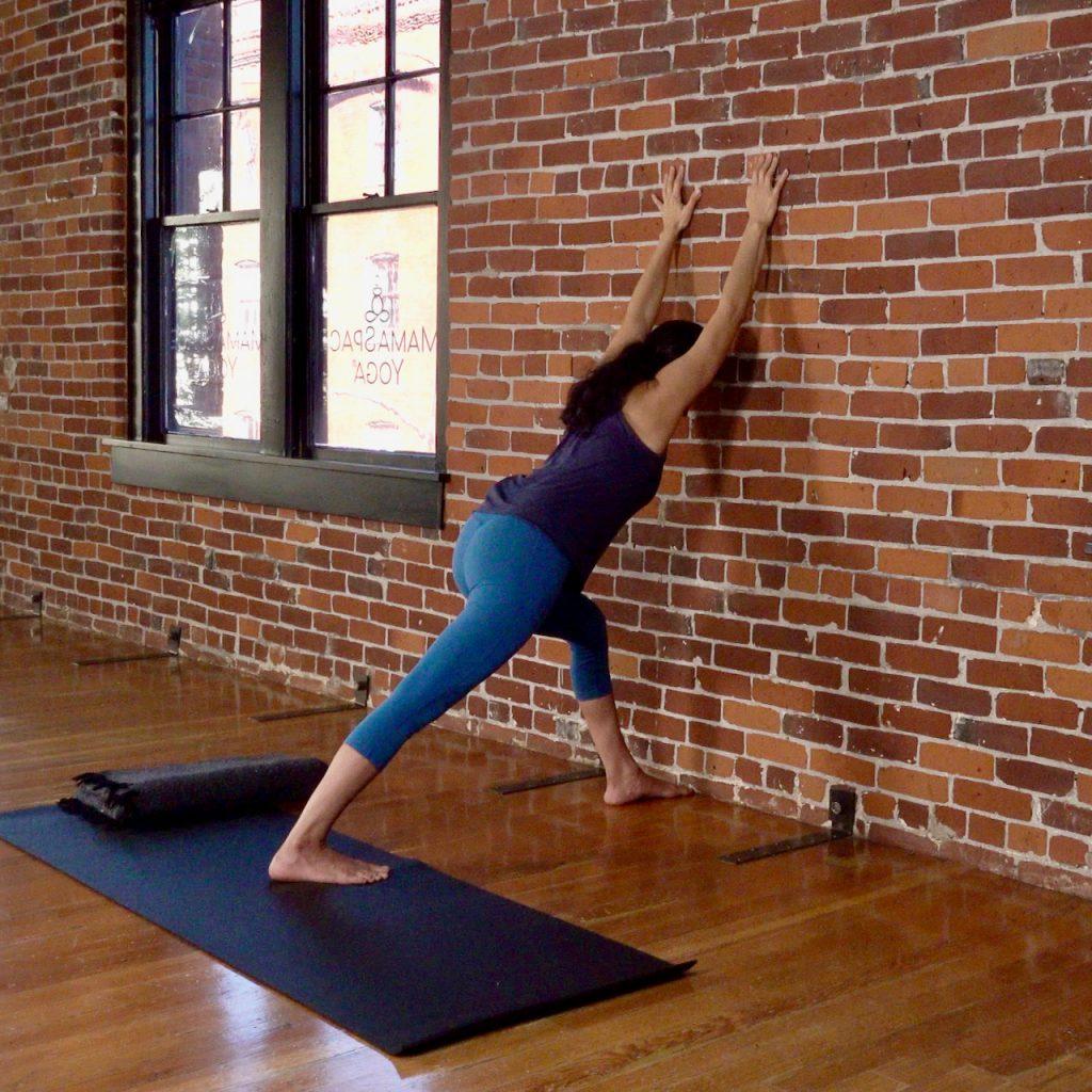 The wall is a prenatal yoga prop at MamaSpace Yoga